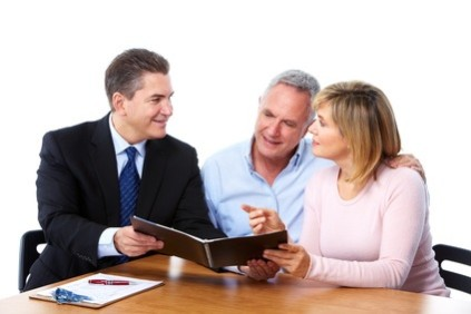 Senior couple with financial adviser